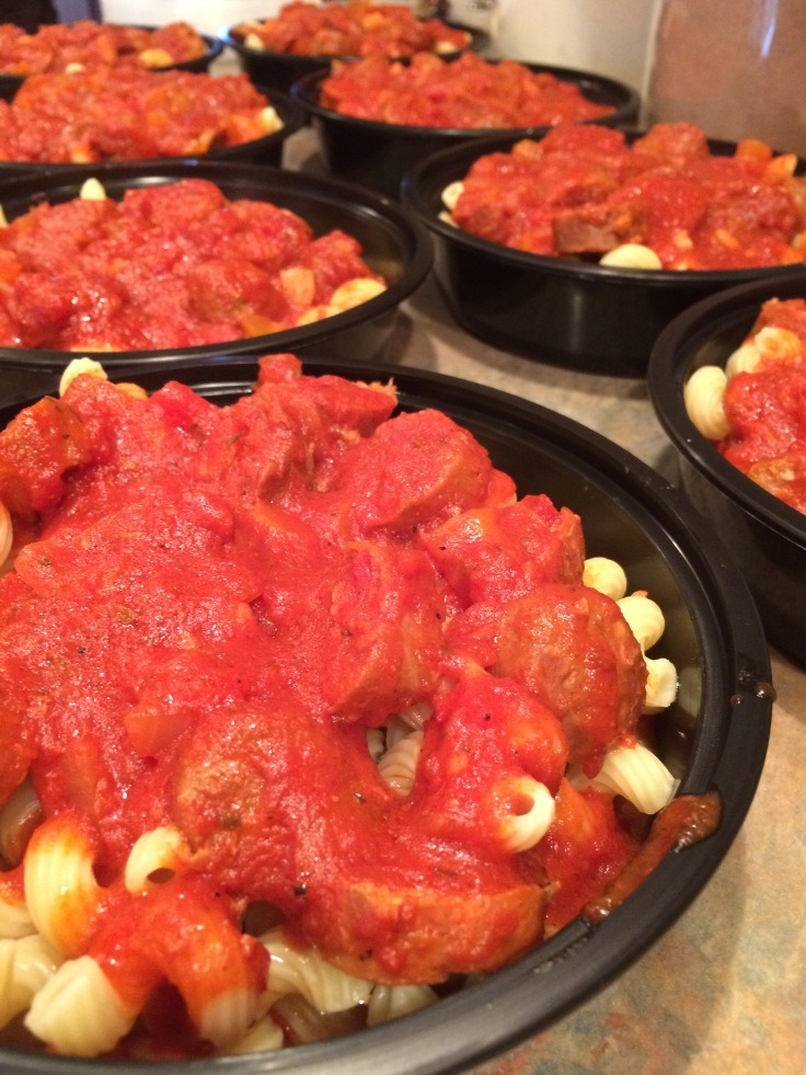 slow cooked sausages sliced over cavatappi with red sauce